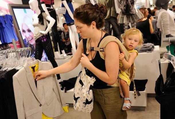 NEW YORK - AUGUST 03:  Susan Lee and Madeline Lee look at pieces from the �Material Girl� clothing line by Madonna at the Material Girl clothing line launch at Macy's Herald Square on August 3, 2010 in New York City.  (Photo by Jemal Countess/Getty Images)