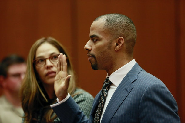 LOS ANGELES, CA - MARCH 23:  Former NFL safety Darren Sharper (R) appears in court with his lawyer Lisa Wayne (L) at Los Angeles Superior Court March 23, 2015 in Los Angeles, California.  Sharper pleaded guilty to charges of sexually assaulting a woman in Arizona as part of a broader plea deal and was sentenced to nine years in federal prison.  Sharper is facing charges in four states for allegedly drugging woman and sexually assaulting them.  (Photo by Nick Ut-Pool/Getty Images)