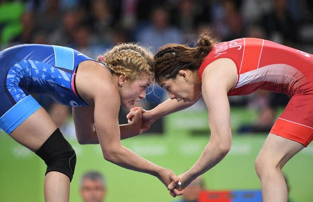 USA's Helen Louise Maroulis (blue) wrestles with Japan's Saori Yoshida in their women's 53kg freestyle final match on August 18, 2016, during the wrestling event of the Rio 2016 Olympic Games at the Carioca Arena 2 in Rio de Janeiro.  / AFP / Toshifumi KITAMURA        (Photo credit should read TOSHIFUMI KITAMURA/AFP/Getty Images)