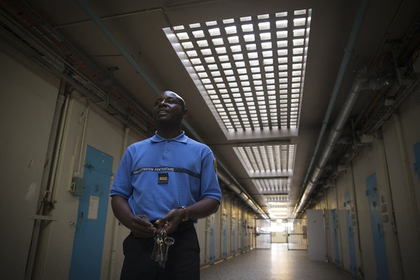 A warden walks on September 10, 2014 in a hallway at the Sante prison in Paris. The only jail in Paris, inaugurated in 1867, closed for renovations on July 21 and is to reopen in 2019 with its prisoners transferred to other facilities. The Sante is known  for its VIP section, where various well-known figures have done time. AFP PHOTO/JOEL SAGET        (Photo credit should read JOEL SAGET/AFP/Getty Images)