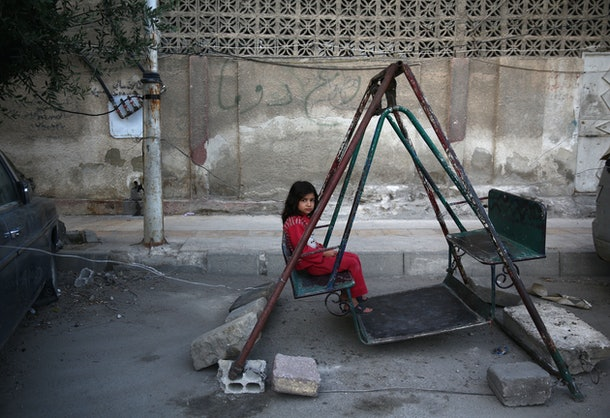 A Syrian girl plays on a swing in the rebel-held town of Douma east of the capital Damascus on the first day of the Eid al-Fitr holiday which marks the end of the Muslim holy fasting month of Ramadan on July 6, 2016.      / AFP / Abd Doumany        (Photo credit should read ABD DOUMANY/AFP/Getty Images)