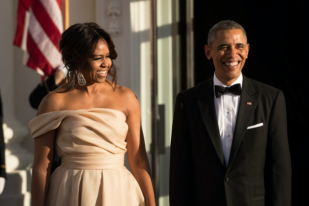 WASHINGTON, DC - MAY 13: First Lady Michelle Obama and U.S. President Barack Obama wait for leaders to arrive for the Nordic state dinner on the North Portico at the White House, May 13, 2016, in Washington, DC. Leaders from Denmark, Norway, Finland, Sweden, and Iceland were invited to the White House for the U.S.-Nordic leaders summit. (Photo by Drew Angerer/Getty Images)