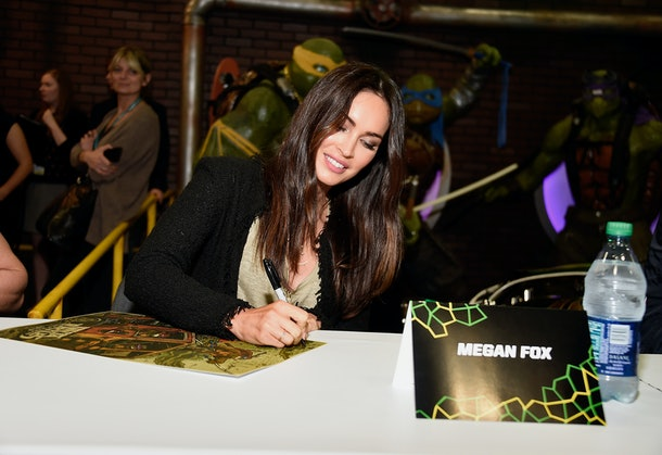 """LOS ANGELES, CA - MARCH 25:  Actress Megan Fox attends an autograph signing at WonderCon 2016 to promote the upcoming release of Paramount Pictures' """"Teenage Mutant Ninja Turtles – Out of The Shadows"""", on March 25, 2016 at the LA Convention Center in Los Angeles, California.  (Photo by Frazer Harrison/Getty Images)"""