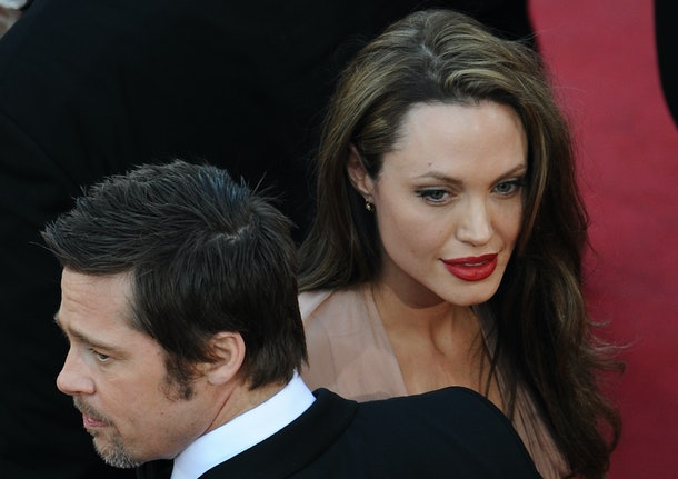 US actor Brad Pitt arrives with actress Angelina Jolie for the screening of the movie 'Inglourious Basterds' directed by US Quentin Tarantino in competition at the 62nd Cannes Film Festival on May 20, 2009.    AFP PHOTO POOL/ MARTIN BUREAU / AFP / POOL / MARTIN BUREAU        (Photo credit should read MARTIN BUREAU/AFP/Getty Images)