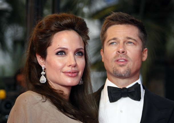 US actors Angelina Jolie (L) and Brad Pitt pose as they arrive to attend the screening of US actor and director Clint Eastwood's film 'The Exchange' at the 61st Cannes International Film Festival on May 20, 2008 in Cannes, southern France. Clint Eastwood and Angelina Jolie drew warm applause at Cannes on May 20, 2008 for a wrenching drama based on a true story of a single mother in 1920s California whose son vanishes.        AFP PHOTO / Francois Guillot / AFP / FRANCOIS GUILLOT        (Photo credit should read FRANCOIS GUILLOT/AFP/Getty Images)