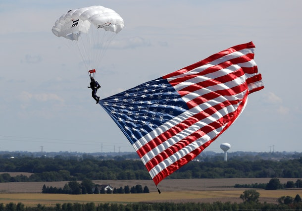 JOLIET, IL - SEPTEMBER 18:  The American Flag is flown in during the NASCAR Sprint Cup Series Teenage Mutant Ninja Turtles 400 at Chicagoland Speedway on September 18, 2016 in Joliet, Illinois.  (Photo by Jonathan Daniel/Getty Images)