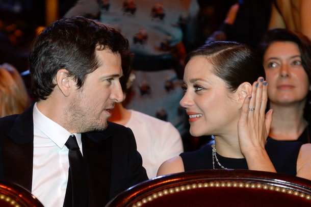 French actor Guillaume Canet (L) and his partner French actress Marion Cotillard attend the 40th edition of the Cesar Awards ceremony on February 20, 2015 at the Chatelet theatre in Paris. AFP PHOTO / BERTRAND GUAY        (Photo credit should read BERTRAND GUAY/AFP/Getty Images)