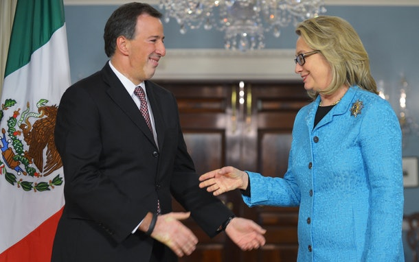 Outgoing US Secretary of State Hillary Clinton shakes hands with peaks with Mexican Foreign Secretary Jose Antonio Meade ahead of their bilateral meeting on January 30, 2013 at the State Department in Washington, DC. The bilateral would be Clinton's last schedule meeting with a foreign leader before stepping down from her post on February 1. AFP PHOTO/Mandel NGAN        (Photo credit should read MANDEL NGAN/AFP/Getty Images)