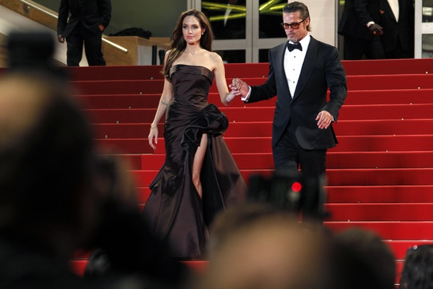 US actors Brad Pitt and Angelina Jolie leave the red carpet after the screening of 'The Tree of Life' presented in competition at the 64th Cannes Film Festival on May 16, 2011 in Cannes.      AFP PHOTO / FRANCOIS GUILLOT / AFP / FRANCOIS GUILLOT        (Photo credit should read FRANCOIS GUILLOT/AFP/Getty Images)
