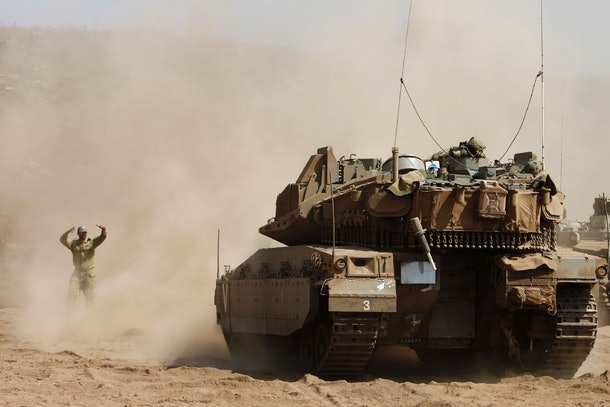 Israeli soldiers manuever a tank during a military exercise in the northern part of the Israeli-annexed Golan Heights on September 13, 2016. / AFP / JALAA MAREY        (Photo credit should read JALAA MAREY/AFP/Getty Images)