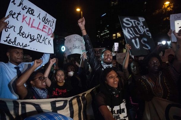 Protesters chant slogans during a march in Charlotte, North Carolina, on September 22, 2016 following the shooting of Keith Lamont Scott by police two days earlier and two nights of riots. The southern US city of Charlotte has imposed a curfew effective midnight Thursday (0400 GMT Friday), on the third night of protests following the fatal police shooting of a black man, the city said.  / AFP / NICHOLAS KAMM        (Photo credit should read NICHOLAS KAMM/AFP/Getty Images)