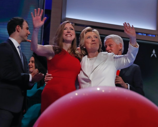 Democratic presidential candidate Hillary Clinton (C-R), daughter Chelsea (C-L), former President Bill Clinton (R) and son-in-law Marc Mezvinsky wave to the audience at the end of the fourth and final day of the Democratic National Convention at Wells Fargo Center on July 28, 2016 in Philadelphia, Pennsylvania.   / AFP / Timothy A. CLARY        (Photo credit should read TIMOTHY A. CLARY/AFP/Getty Images)
