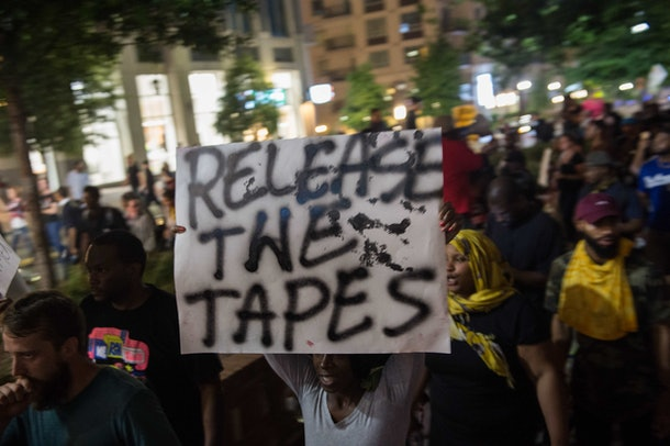 Protesters march in Charlotte, North Carolina, on September 23, 2016 following the shooting of Keith Lamont Scott by police three days earlier and subsequent unrest in the city. Hundreds of protesters were out again on Friday night calling for the release of the videos amid a greater presence of National Guard troops, but the atmosphere was calmer than during previous days.  / AFP / NICHOLAS KAMM        (Photo credit should read NICHOLAS KAMM/AFP/Getty Images)