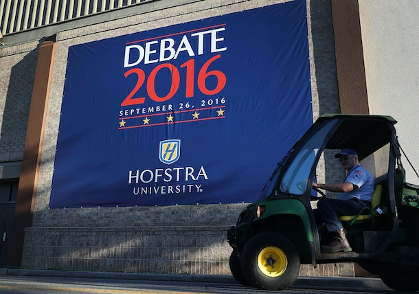 HEMPSTEAD, NY - SEPTEMBER 24:  A debate sign hangs on a wall outside the media center setup for the first U.S. presidential debate at Hofstra University on September 24, 2016 in Hempstead, New York. Democratic presidential candidate Hillary Clinton is scheduled to debate Republican presidential candidate Donald Trump on September 26.  (Photo by Joe Raedle/Getty Images)