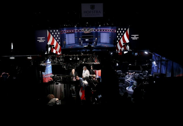 HEMPSTEAD, NY - SEPTEMBER 25:  Network television news crews prepare their studios as students acting as 'stand-ins' for Democratic presidential candidate Hillary Clinton and Republican presidential candidate Donald Trump take part in a rehearsal for the first U.S. presidential debate at Hofstra University on September 25, 2016 in Hempstead, New York. Clinton is scheduled to debate Trump tomorrow evening. Pictured (L-R) are Hofstra students Joseph Burch and Caroline Mullen.  (Photo by Win McNamee/Getty Images)