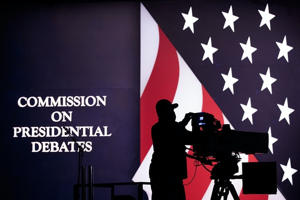 HEMPSTEAD, NEW YORK - SEPTEMBER 25: Television news crews prepare for the first presidential debate featuring Democratic presidential candidate Hillary Clinton and Republican presidential candidate Donald Trump at Hofstra University on September 25, 2016 in Hempstead, New York. Democratic presidential candidate Hillary Clinton is scheduled to debate Republican presidential candidate Donald Trump on Monday night. (Photo by Drew Angerer/Getty Images)