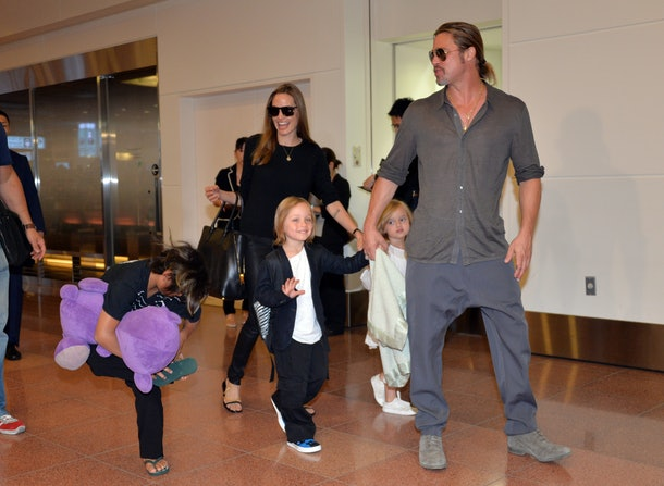 US film stars Brad Pitt (R) and Angelina Jolie (C), accompanied by their children, arrive at Haneda International Airport in Tokyo on July 28, 2013.  Pitt is now here for the promotion of his latest movie 'World War Z'.     AFP PHOTO / Yoshikazu TSUNO        (Photo credit should read YOSHIKAZU TSUNO/AFP/Getty Images)