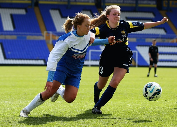 BIRMINGHAM, ENGLAND - MAY 01:  Mollie Rouse of Stratford Upon Avon and Erin Deake of St Bedes RC High School challenge for the ball during the Premier League Under 16 Schools Cup for Girls during The Premier League Schools Cup Final Day at St Andrews (stadium) on May 1, 2015 in Birmingham, England.  (Photo by Matthew Lewis/Getty Images for Premier League)