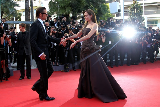 US actors Brad Pitt and Angelina Jolie walk on the red carpet before the screening of 'The Tree of Life' presented in competition at the 64th Cannes Film Festival on May 16, 2011 in Cannes.       AFP PHOTO / VALERY HACHE / AFP / VALERY HACHE        (Photo credit should read VALERY HACHE/AFP/Getty Images)