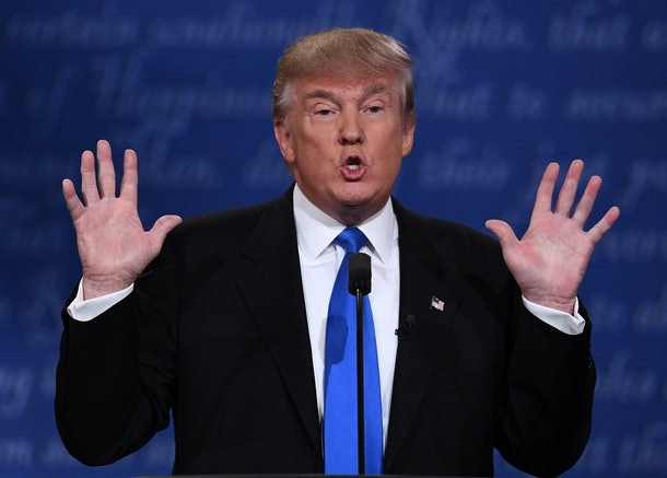 Republican nominee Donald Trump gestures during the first presidential debate at Hofstra University in Hempstead, New York on September 26, 2016. / AFP / Jewel SAMAD        (Photo credit should read JEWEL SAMAD/AFP/Getty Images)
