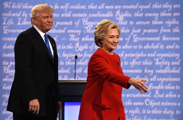 Democratic nominee Hillary Clinton (R) and Republican nominee Donald Trump walk off the stage after the first presidential debate at Hofstra University in Hempstead, New York on September 26, 2016. / AFP / Timothy A. CLARY        (Photo credit should read TIMOTHY A. CLARY/AFP/Getty Images)