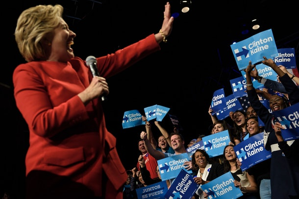 Democratic presidential nominee Hillary Clinton cheers with supporters at The Space at Westbury after the first US Presidential Debate at Hofstra University September 26, 2016 in Westbury, New York. / AFP / Brendan Smialowski        (Photo credit should read BRENDAN SMIALOWSKI/AFP/Getty Images)