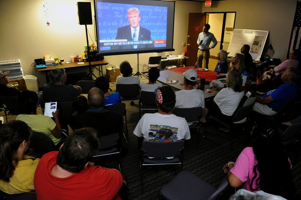 Supporters of  Republican presidential nominee Donald Trump watch the first presidential debate between Republican nominee Donald Trump and Democratic presidential nominee Hillary Clinton at the Colorado Republican Party's Adams County Victory Office in Thornton, Colorado, on September 26, 2016.  / AFP / Jason Connolly        (Photo credit should read JASON CONNOLLY/AFP/Getty Images)