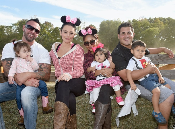 LONG VALLEY, NJ - SEPTEMBER 26:  (EXCLUSIVE COVERAGE) (L-R) Roger Mathews,Meilani Alexandra Mathews,Jenni 'JWoww' Farley,Nicole 'Snooki' Polizzi,Giovanna Marie LaValle,Jionni LaValle and Lorenzo Dominic Lavalle go on a hayride at a joint birthday party for Lorenzo And Giovanna at ORT Farms on September 26, 2015 in Long Valley, New Jersey.  (Photo by Jamie McCarthy/Getty Images)