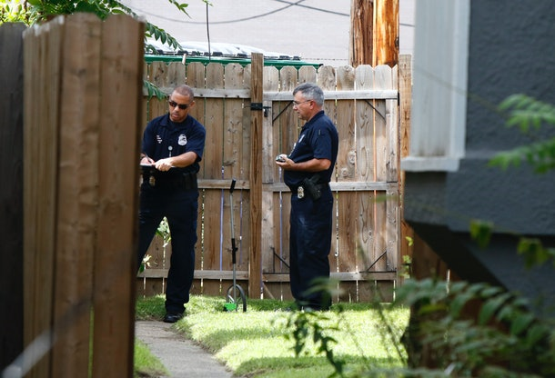Members of the Columbus Police Crime Scene Search Unit are seen behind a residence on  Hoffman Avenue on September 15, 2016, near the scene of a police shooting of 13-year-old Tyree King in Columbus, Ohio. An officer responding to reports of a robbery shot and killed a 13-year-old boy in Columbus, Ohio after he drew what turned out to be a BB gun, a type of air gun that shoots pellets, police said. The Columbus police department said it was investigating the death Wednesday night of Tyree King, the latest in a string of officer involved shootings that have fueled protests and national debate about policing tactics in US cities.  / AFP / Paul Vernon        (Photo credit should read PAUL VERNON/AFP/Getty Images)