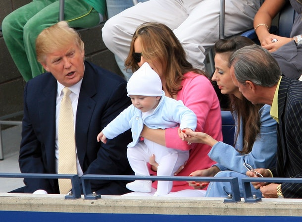 NEW YORK - SEPTEMBER 10:  Donald Trump, baby son Barron and wife Melania Trump watch the men's final between Roger Federer of Switzerland and Andy Roddick during the U.S. Open at the USTA Billie Jean King National Tennis Center in Flushing Meadows Corona Park on September 10, 2006 in the Flushing neighborhood of the Queens borough of New York City.  (Photo by Jamie Squire/Getty Images)