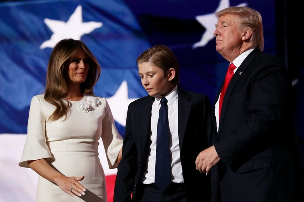 CLEVELAND, OH - JULY 21:  Republican presidential candidate Donald Trump (R) embraces his son Barron Trump, as his wife Melania Trump looks on at the end of the Republican National Convention on July 21, 2016 at the Quicken Loans Arena in Cleveland, Ohio. Republican presidential candidate Donald Trump received the number of votes needed to secure the party's nomination. An estimated 50,000 people are expected in Cleveland, including hundreds of protesters and members of the media. The four-day Republican National Convention kicked off on July 18.  (Photo by Chip Somodevilla/Getty Images)
