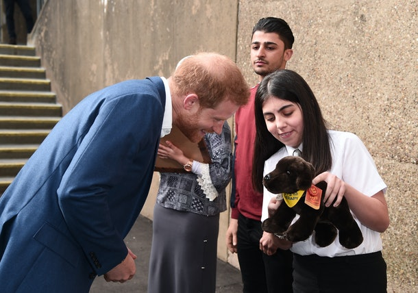 Prince Harry receiving a gift from Meghan Markle's pen pal, Aleyna Genc