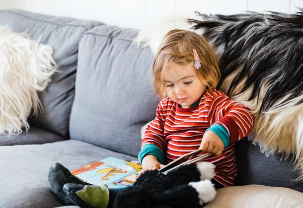 Your toddler's obsession with books is partly because of you reading to them so often, experts say.