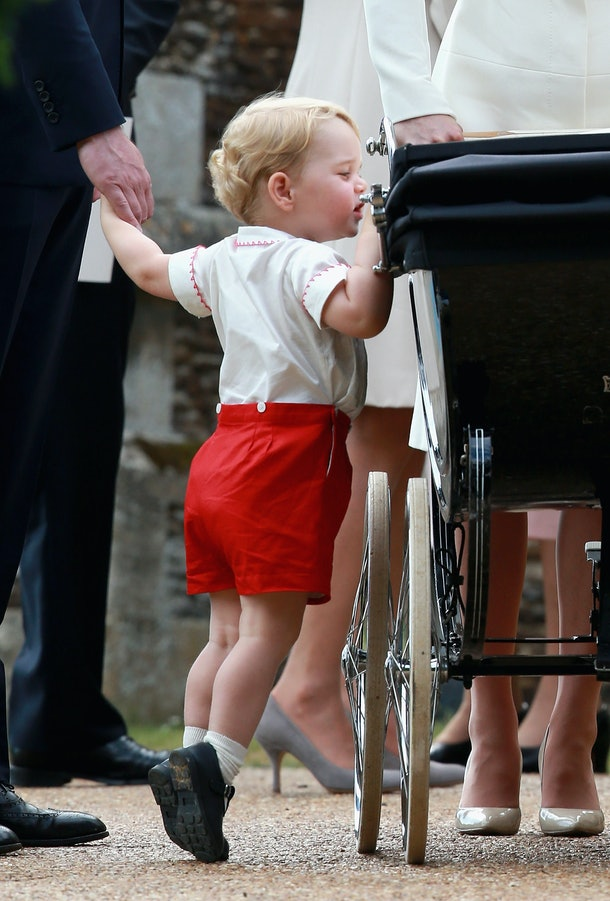 Prince George checks out his baby sister at her christening in 2015