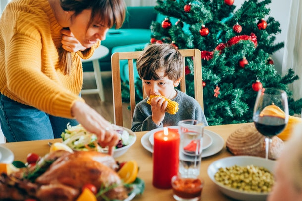 Experts say it's totally OK if all your kid picks at on Thanksgiving is the roll.