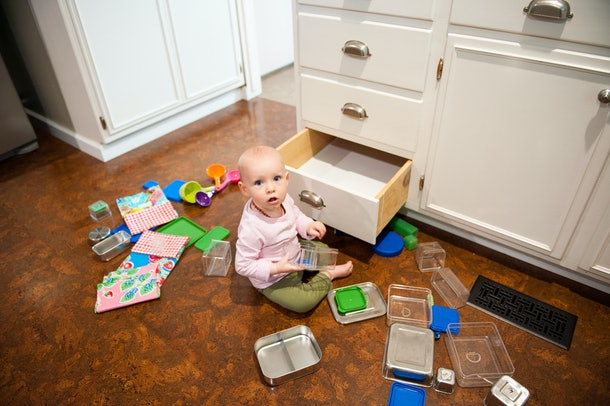 Babies love playing in drawers to develop a sense of awareness and explore their surroundings.