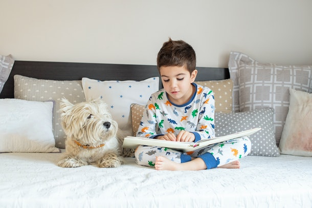 A recent study found that kids read longer with dogs present.