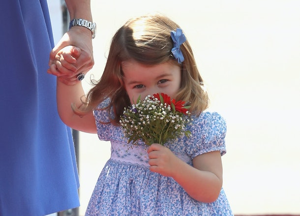 Princess Charlotte smelled flowers as she walked with her mom in Germany