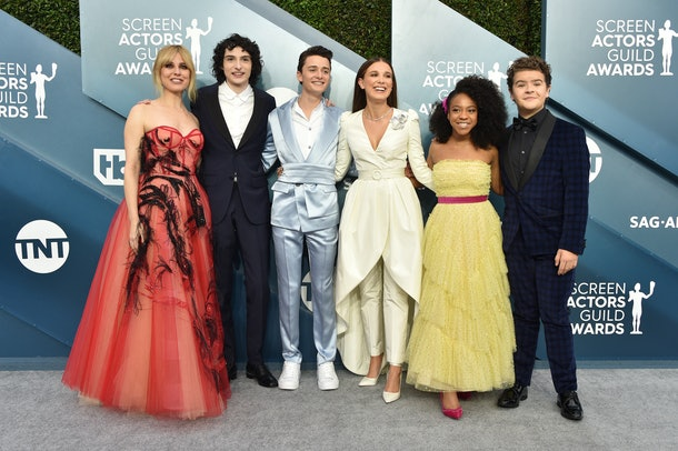 "Millie Bobby Brown poses alongside some of her ""Stranger Things"" co-stars at the 2020 SAG Awards on Sunday."