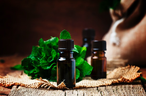 Essential oils smell great, but can a drop of peppermint oil in the toilet help you poop?