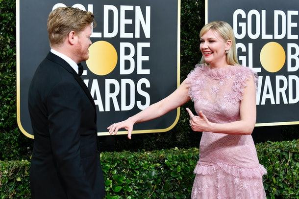 Kirsten Dunst and her husband turned the Golden Globes (and her Rodarte dress) into a date night.