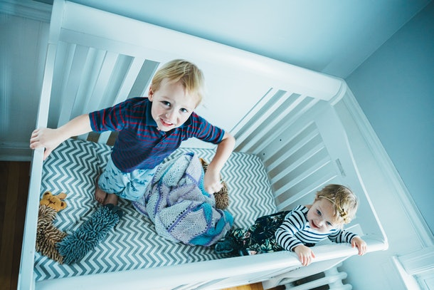 Keeping siblings in different rooms may keep your toddler from climbing out of a crib.