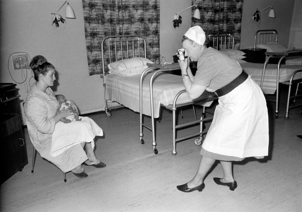 Midwife May Guthrie-Lacy snaps a photo of a mom and brand new baby in 1969.