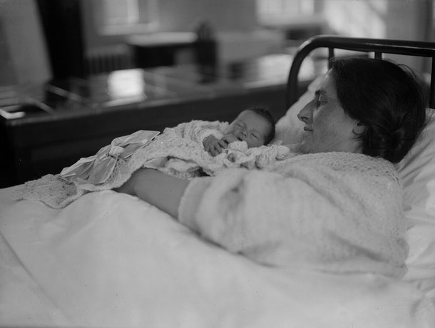 This 1931 photo of a new mom and her baby proves that a mother's love is forever timeless.