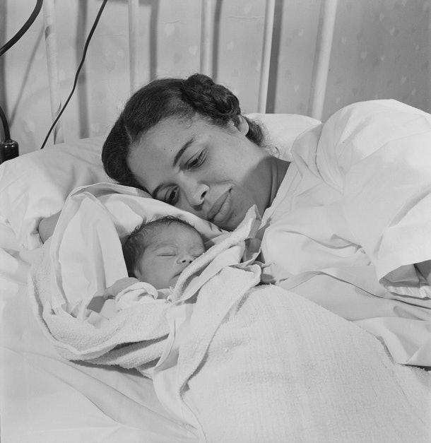 This 1945 photo of a mother nestled into her newborn baby is just lovely.