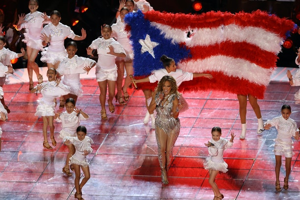 J. Lo performs on stage at the Super Bowl with her daughter.
