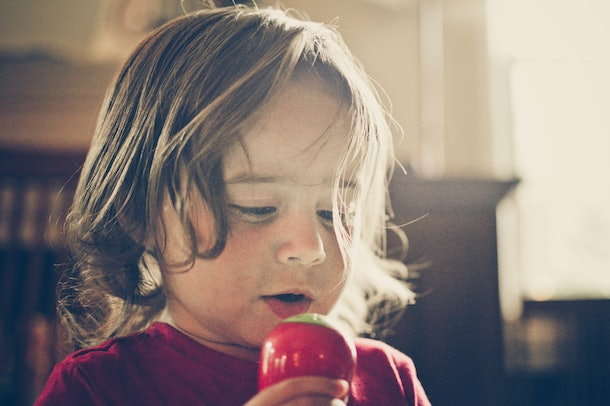 toddler singing into a toy microphone