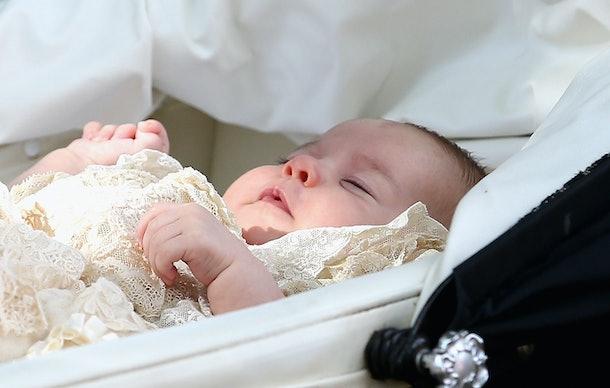 Princess Charlotte looks sleepy in her bassinet