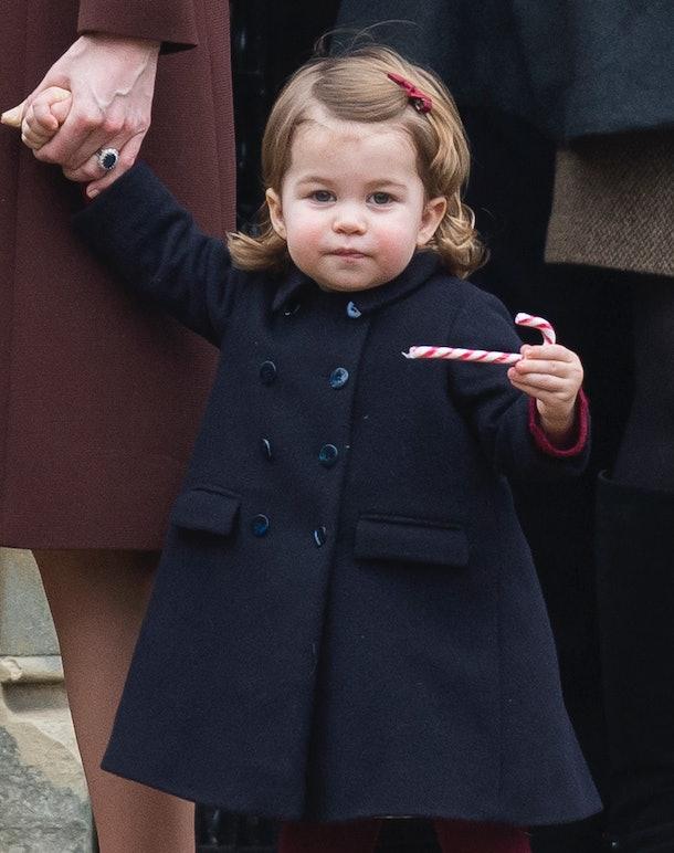 Princess Charlotte enjoys a candy cane