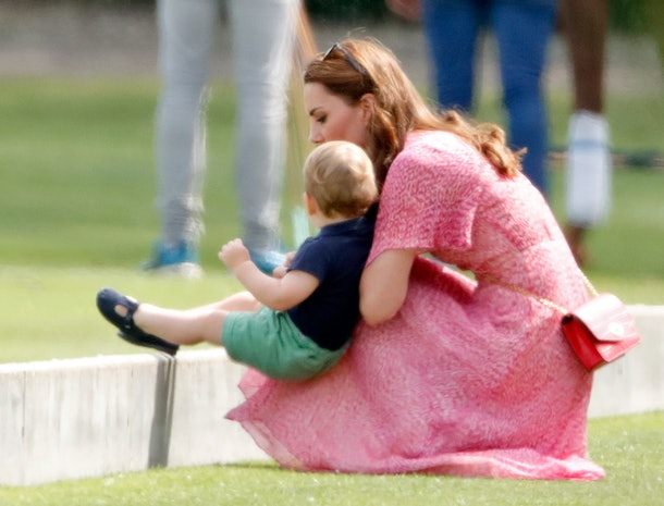 Prince Louis uses his mom as a chair.